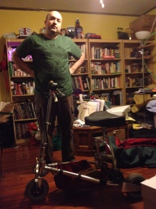 My partner standing regally behind the assembled TravelScoot