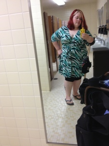 A selfie in the work bathroom mirror as usual. The green, black, & white zebra dress is from Kiyonnna via Gwynnie Bee with visible black capri teggings & ballet flats.