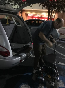 My husband setting up my scooter at Target...first time using it for shopping.
