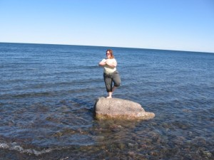 Doing tree pose on a rock in Lake Superior, 2006