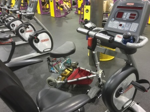 My scooter next to a recumbent bike at Planet Fitness